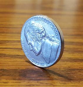 Nickel sitting on its edge