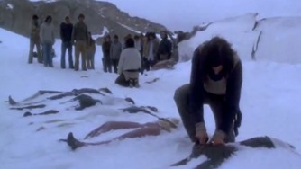 Scene from the movie Alive, dead bodies in the snow